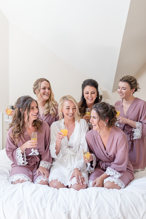 cheers with the bridesmaids