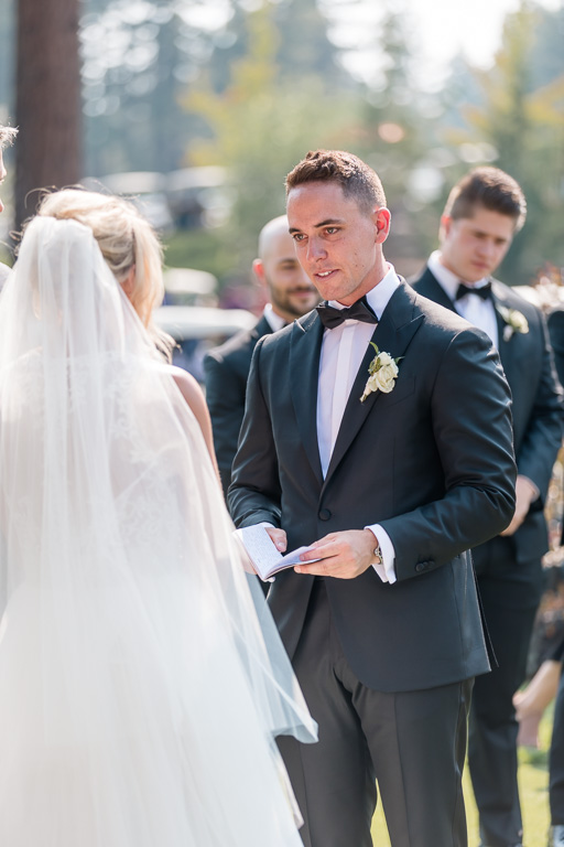 groom reads his sweet vows