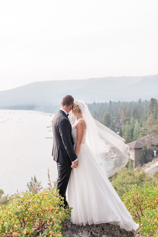 unique Lake Tahoe wedding photo up on a mountain overlooking the valley