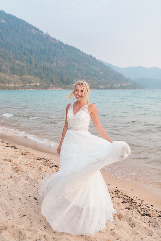 playful bridal wedding portrait on Lake Tahoe Sand Harbor beach