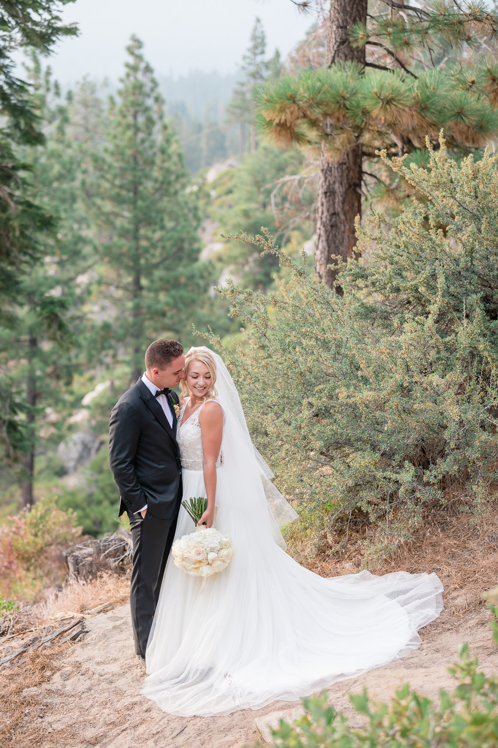 adventurous outdoorsy wedding photo on top of the Take Tahoe mountains