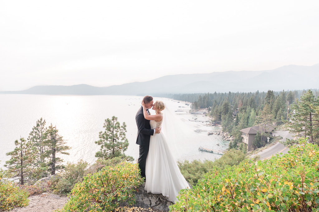 panorama wide angle wedding photo of Lake Tahoe and mountain background
