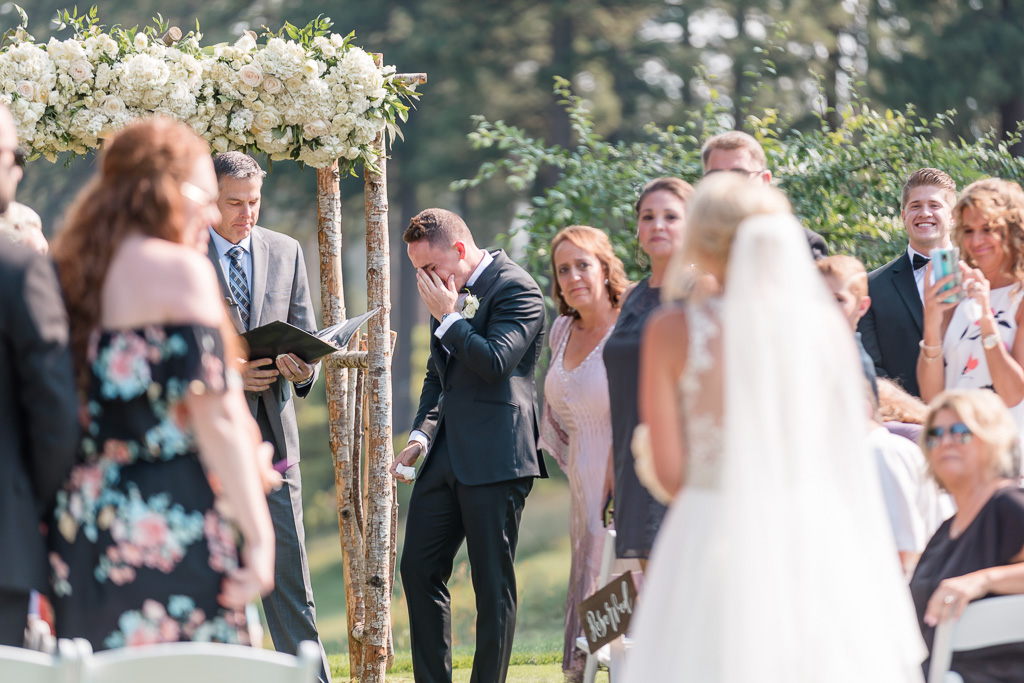 groom sobbing with emotion as bride walks down the aisle - Lake Tahoe outdoor wedding