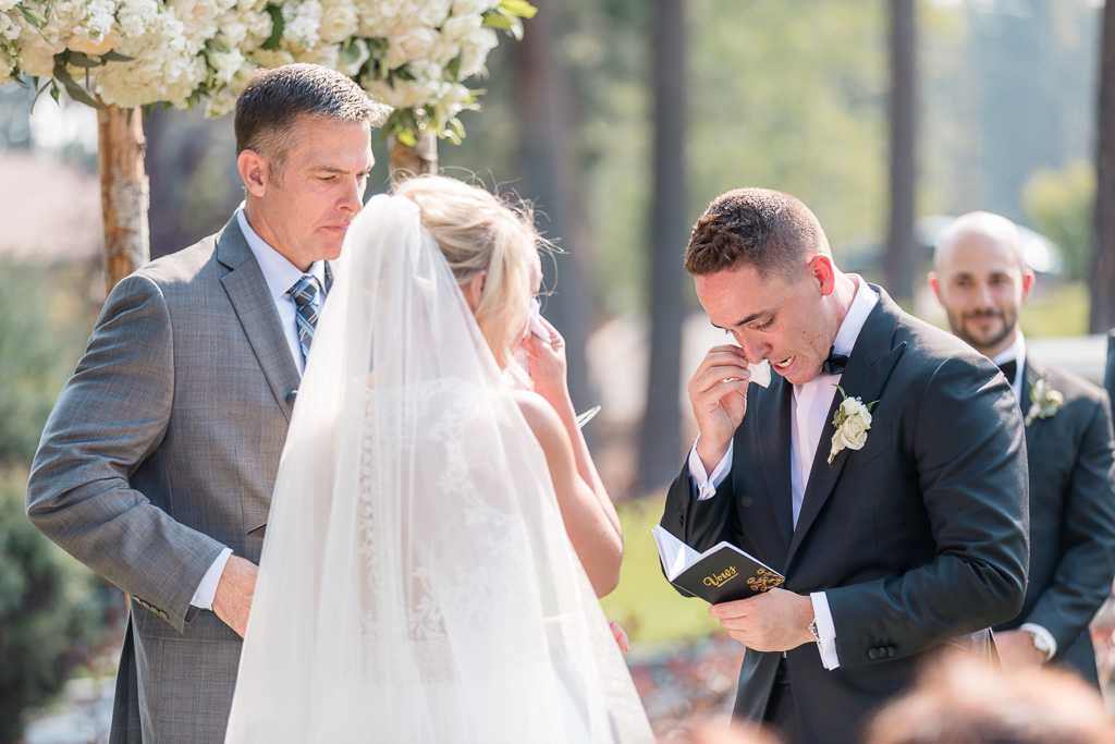 emotional Lake Tahoe wedding - bride and groom both crying during their vow exchange