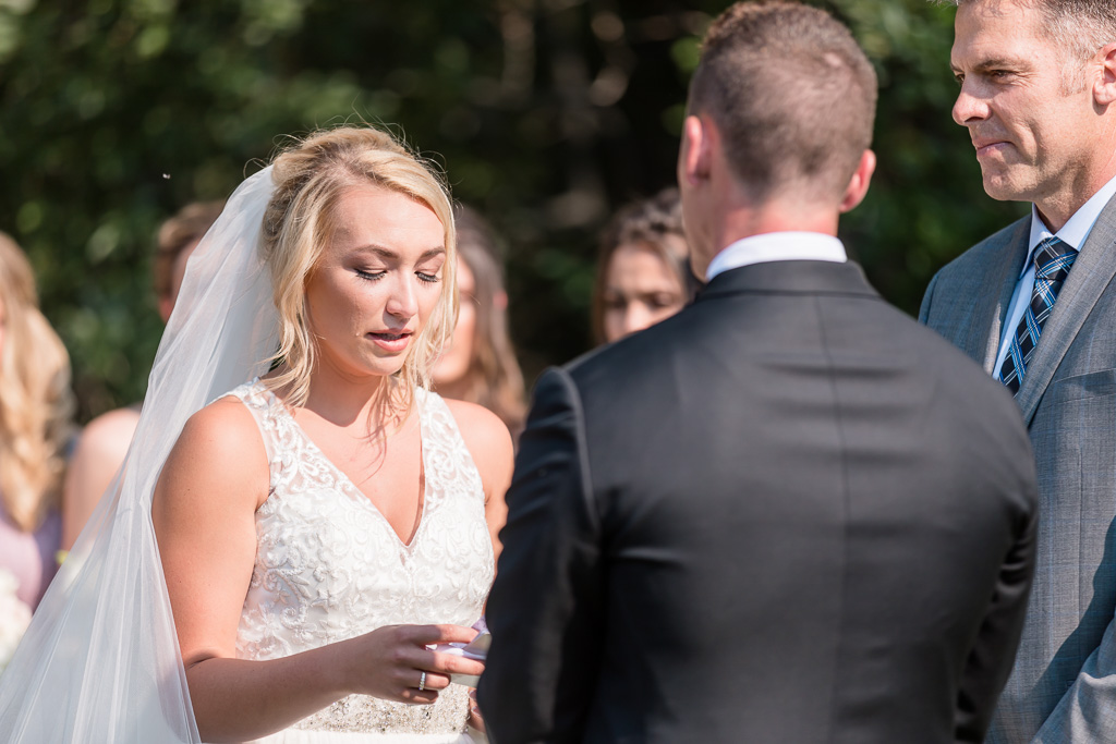 bride's tears rolling down her cheek when reading her vows