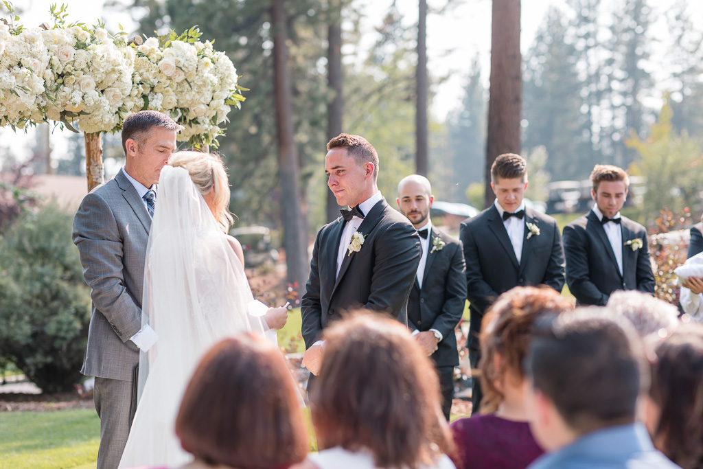 groom looks at his bride lovingly at the ceremony