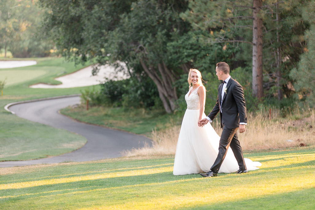 The Chateau at Incline Village wedding, newlyweds walking on the golf course