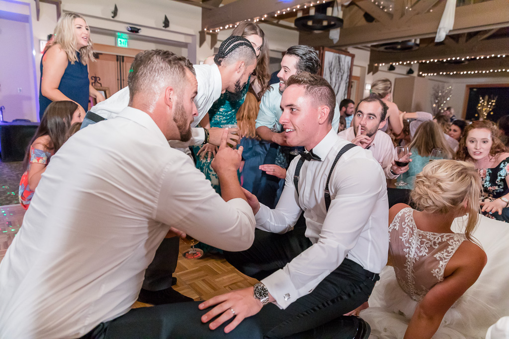 groom dancing with groomsman
