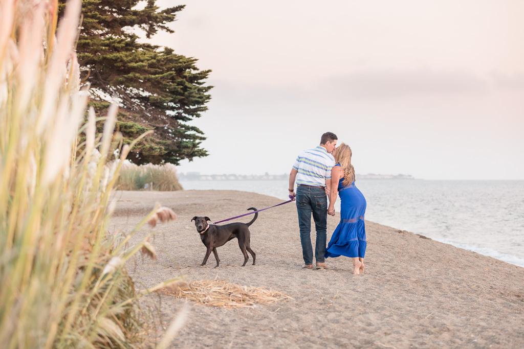 Crown Memorial State Beach engagement photo with a puppy