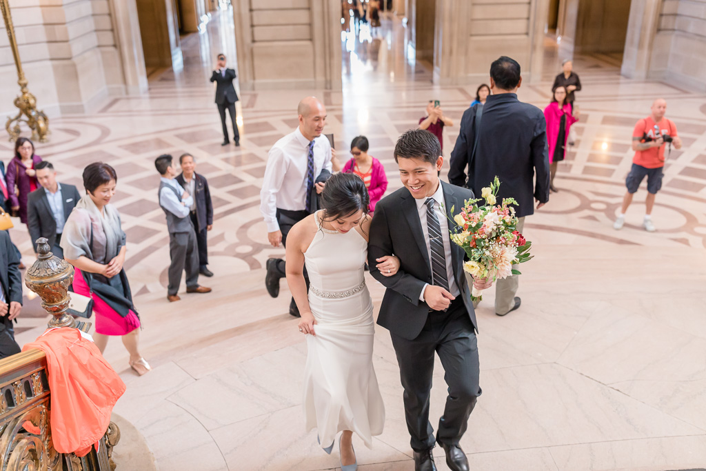 walking up the staircase to their civil ceremony spot