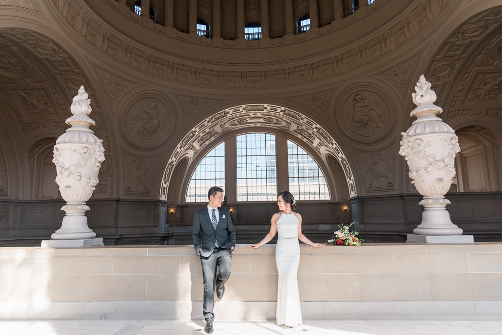 stunning bride and groom portrait in San Francisco City Hall under the dome