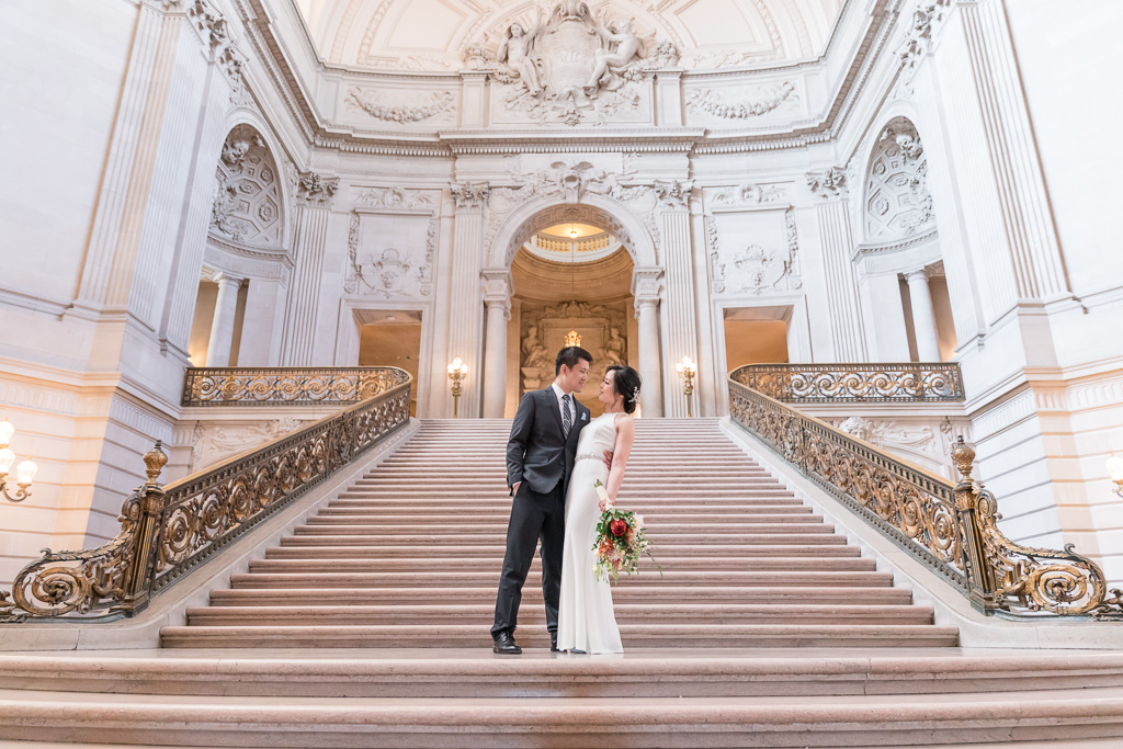 wedding photo on the big staircase at San Francisco city hall