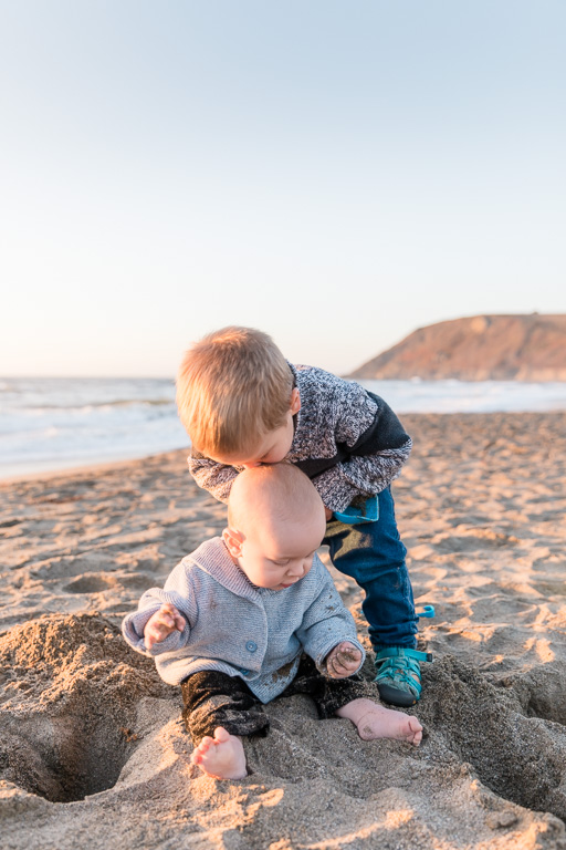 san francisco family photographer - older brother kissing the little one on his forehead