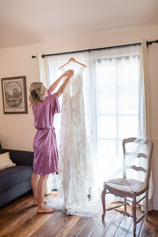 bride getting her wedding gown down