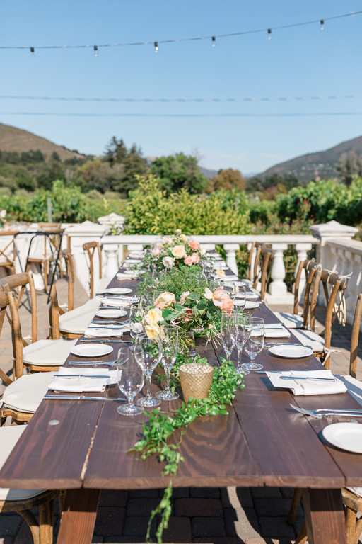 long farm table setup at Folktale winery for an outdoor reception