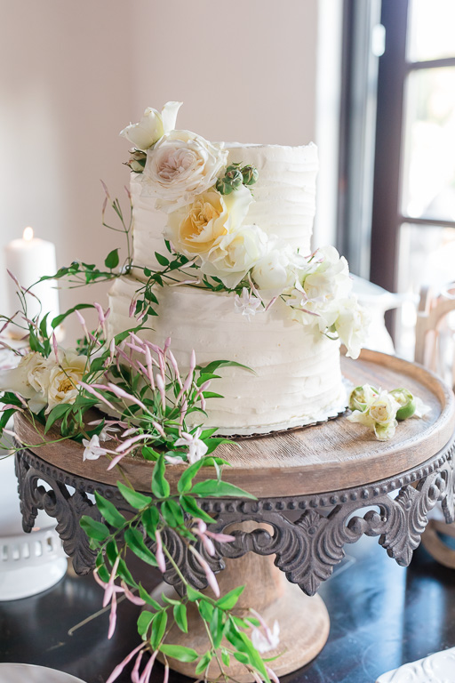 a simple wedding cake decorated with flowers