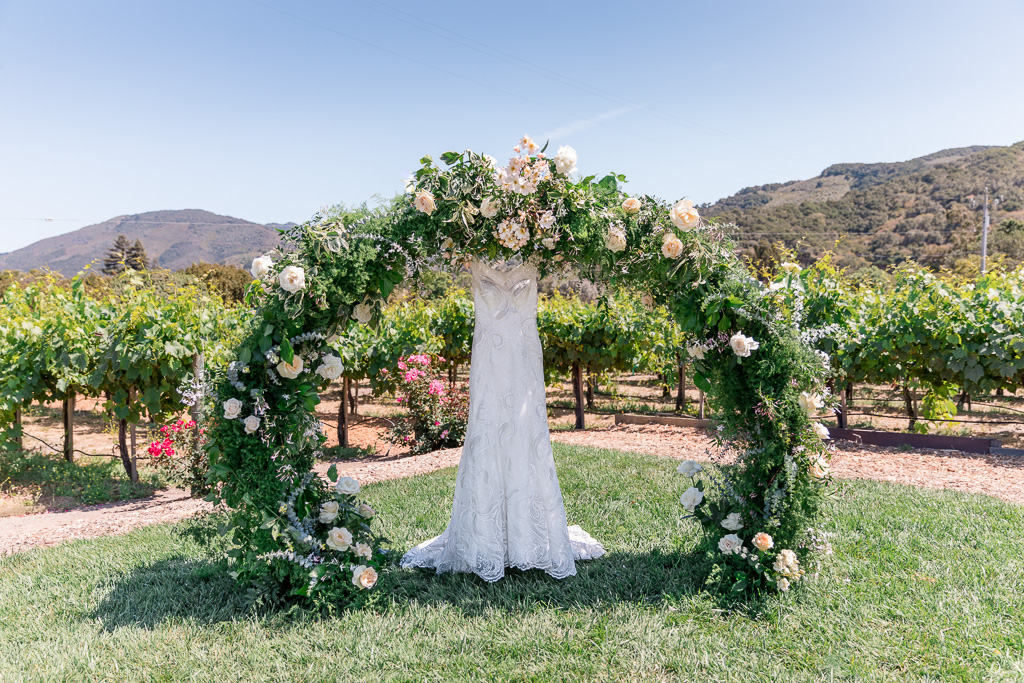 circle ceremony arch decorated with flowers