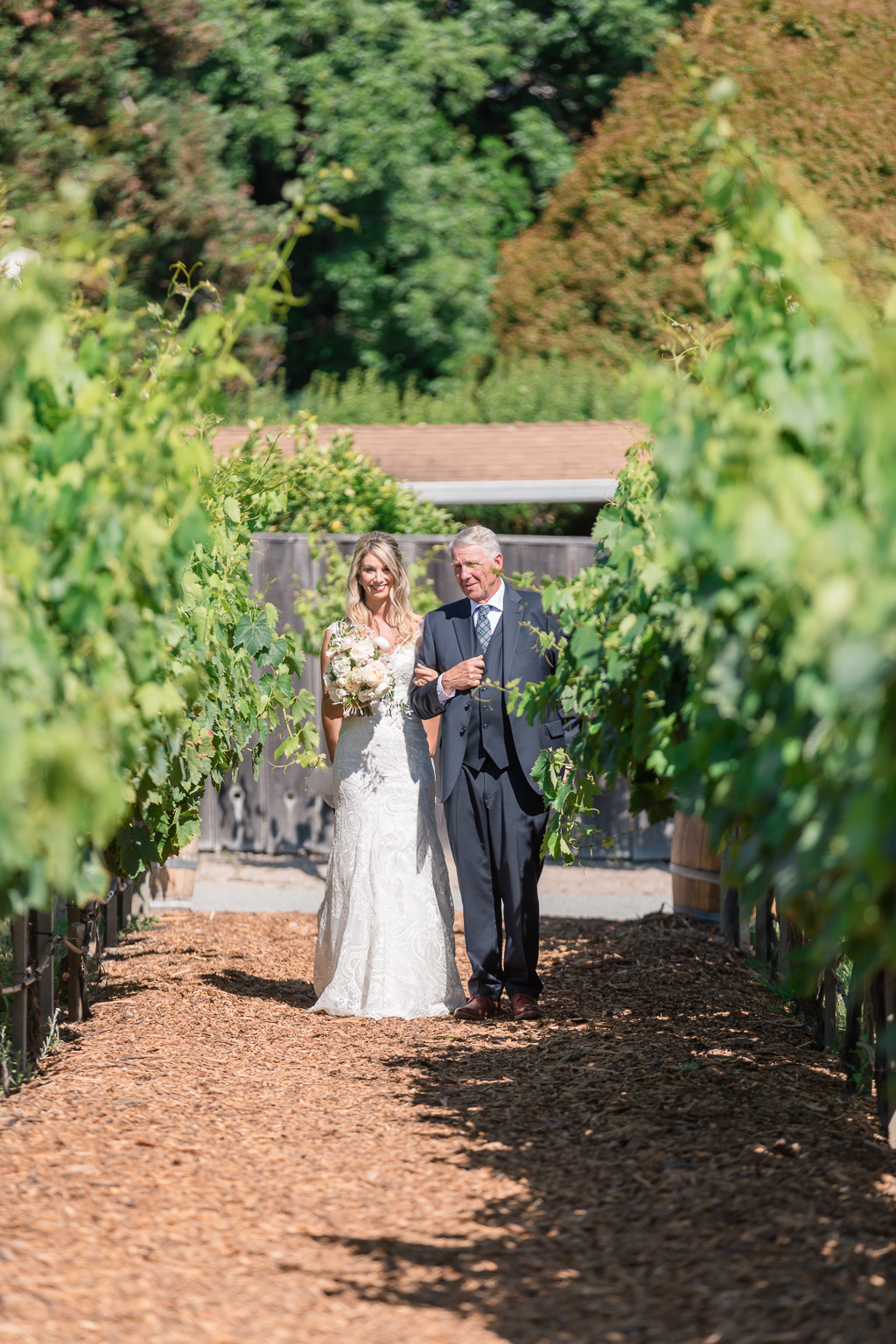 bride and father waiting inside the vineyards