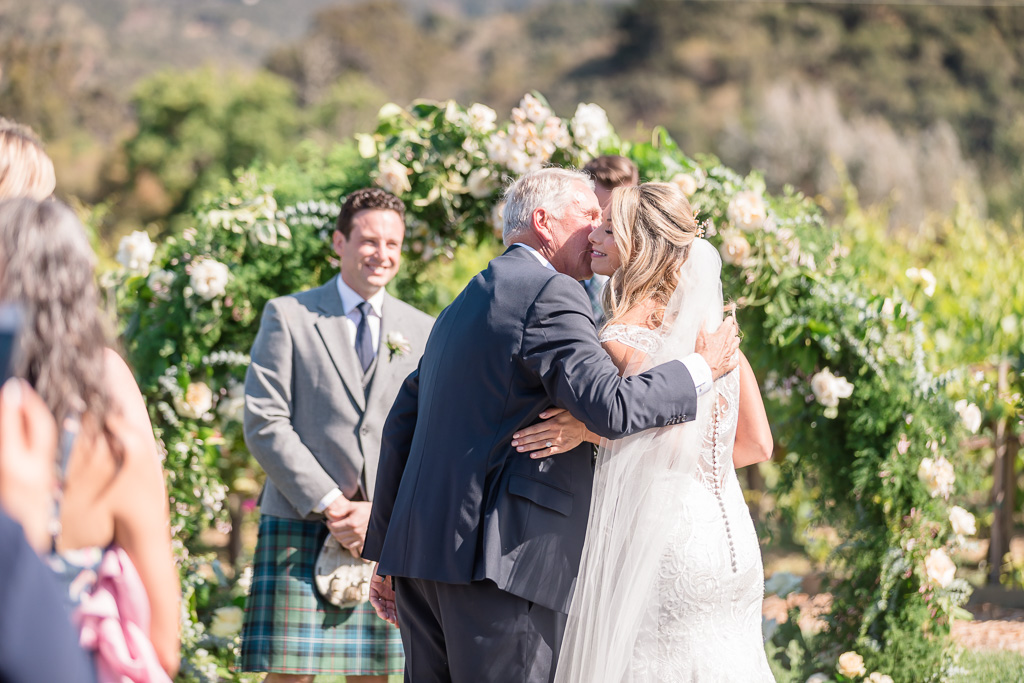 the emotional moment when father giving the bride away at a Carmel-by-the-Sea summer wedding