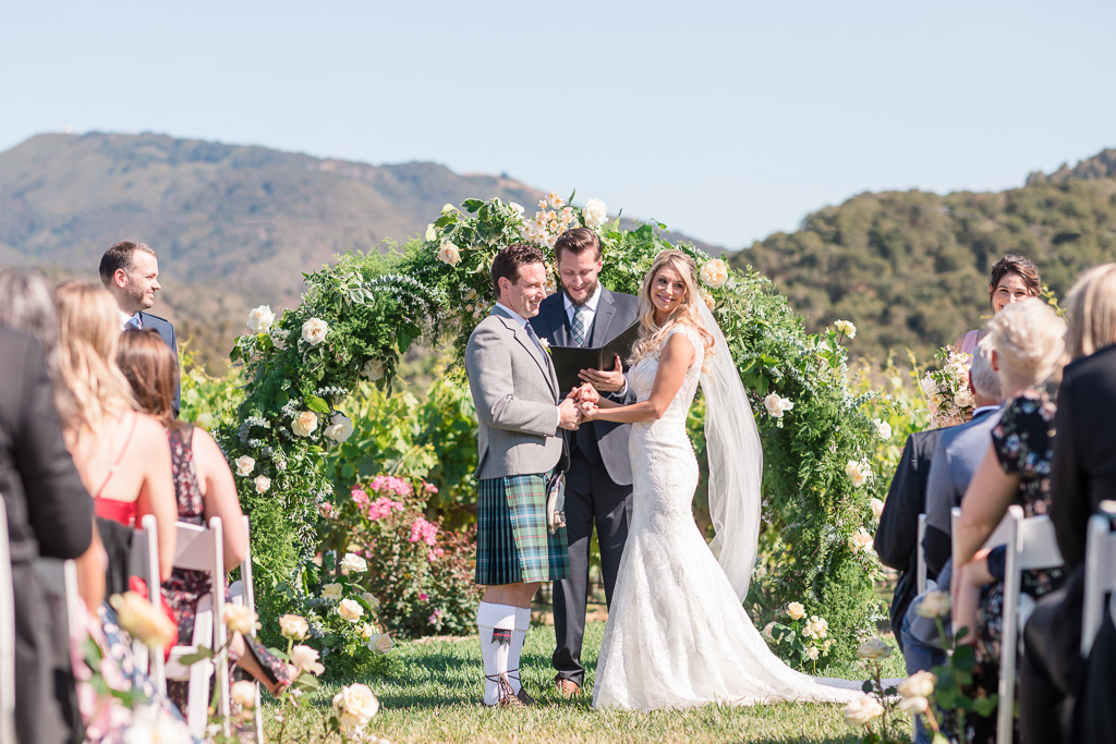 our happy couple during their vineyard wedding ceremony in Carmel