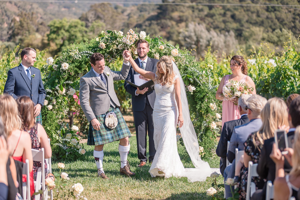 wedding ceremony with a circle arch and kilts