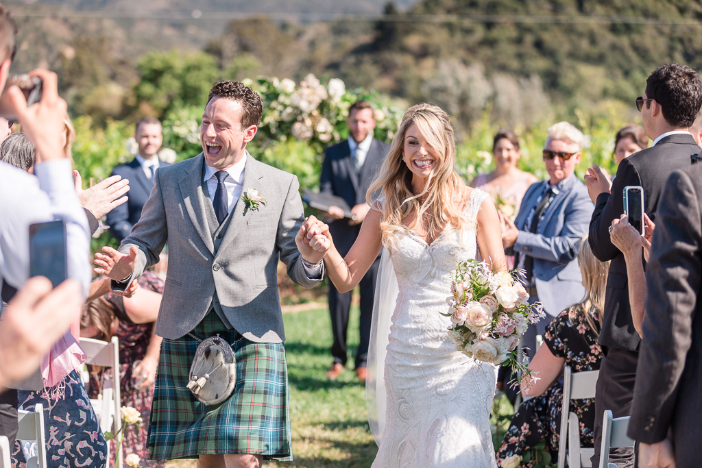 couple walks down the aisle as husband and wife