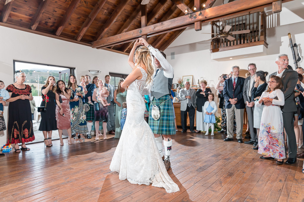 couple's first dance in the barn house
