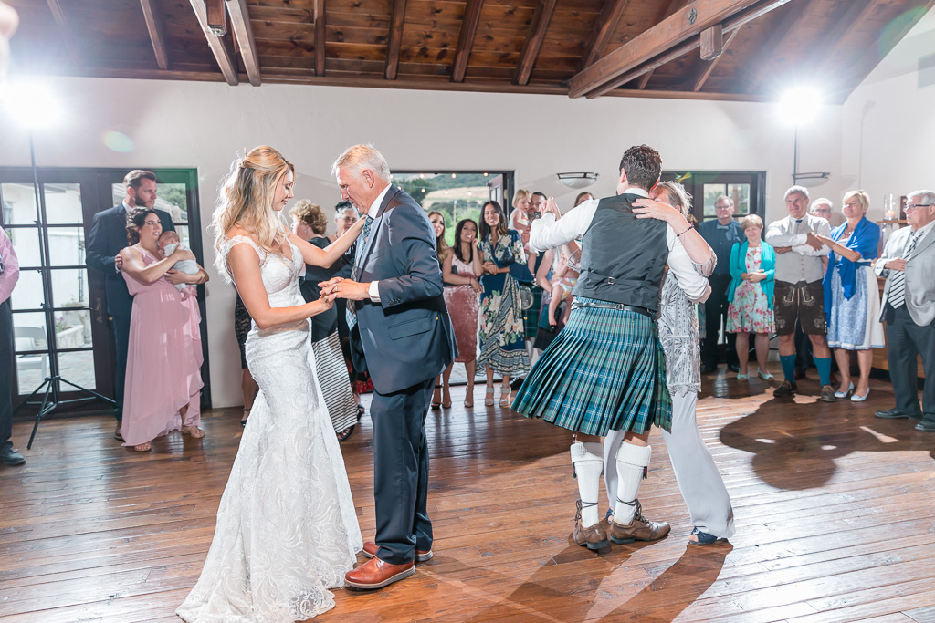bride and groom dance with their parents at the same time