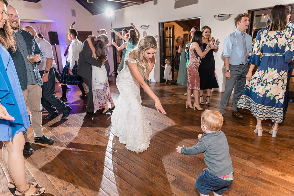 little guest dancing with the bride