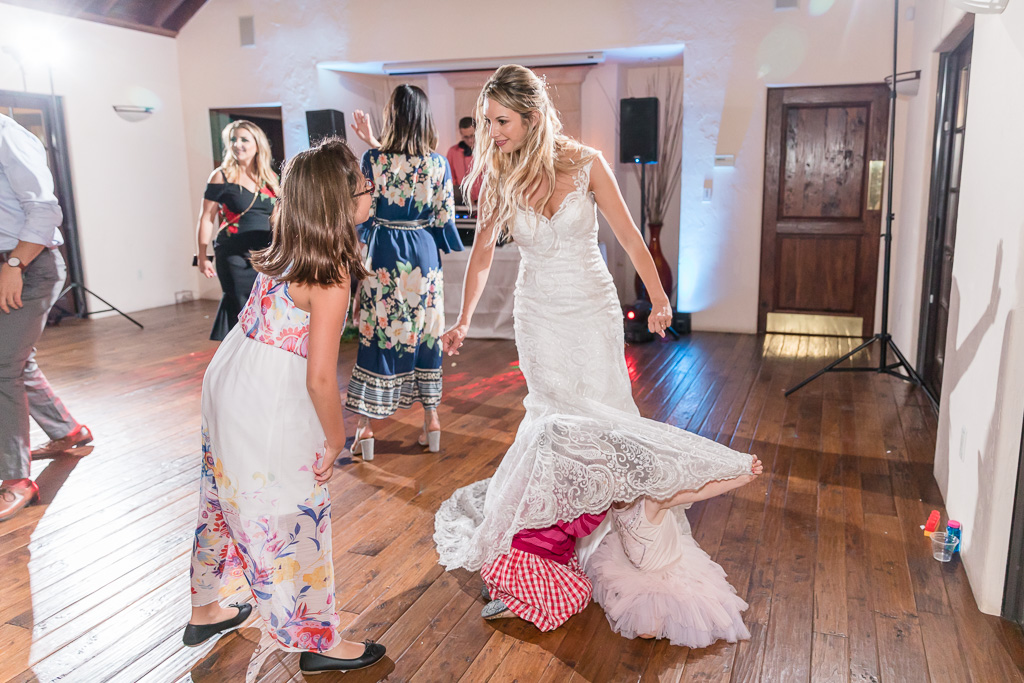 little guests all love hiding under the bride's dress