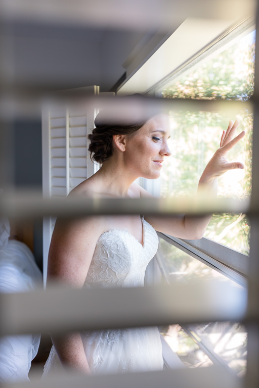 cute moment when bride peeks out of the window