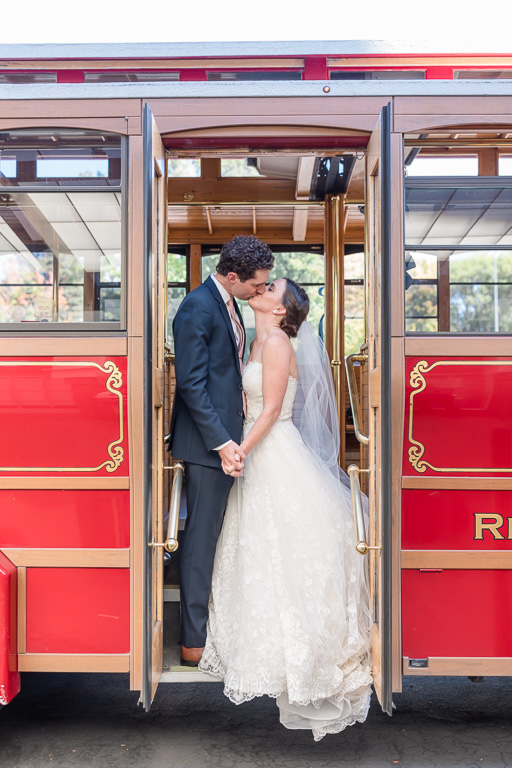 bride and groom wedding portrait on Rosie the trolley