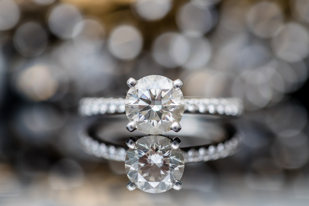 stunning diamond wedding ring shot with reflections