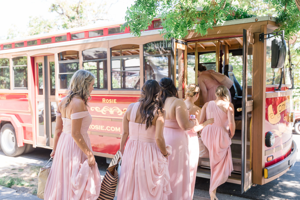 wedding party getting on the trolley