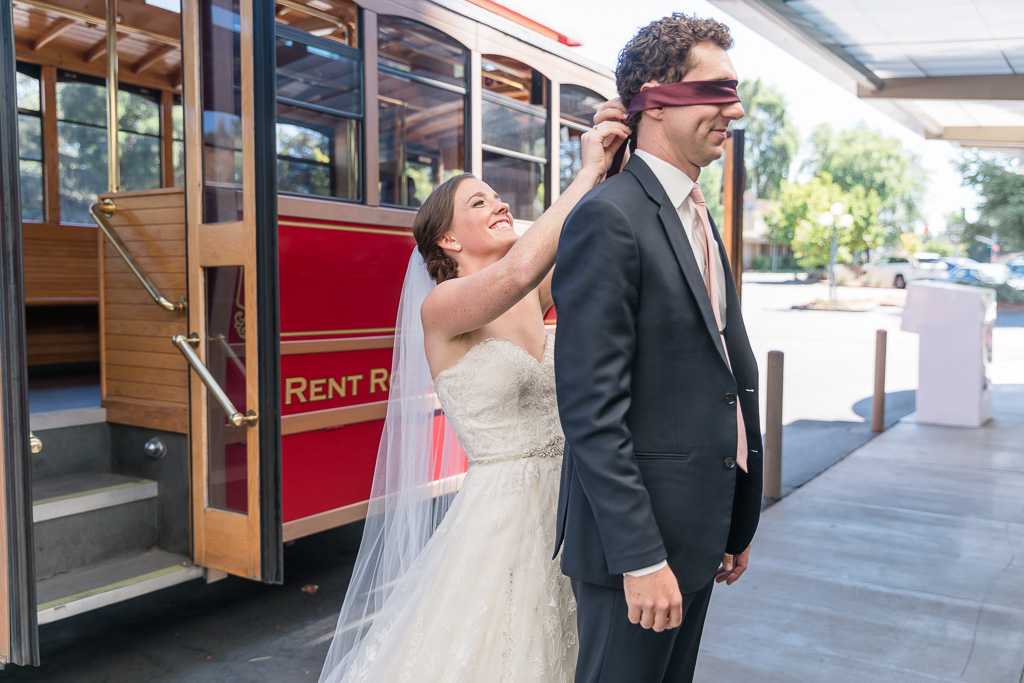 wedding first look in front of Rosie the Santa Rosa trolley
