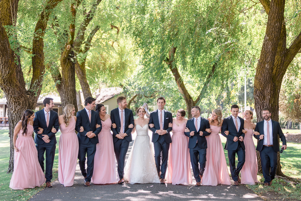 wedding party photo in the Wild Oak Saddle Club tree tunnel