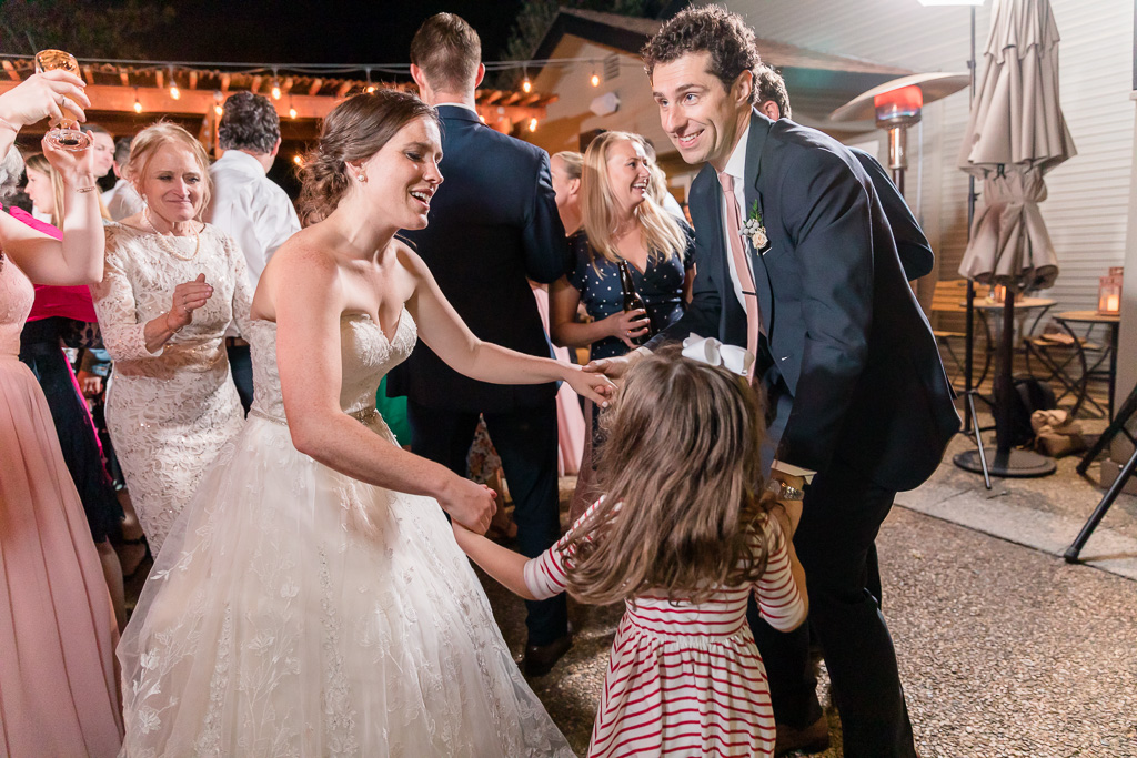 newlyweds dancing with their little guest