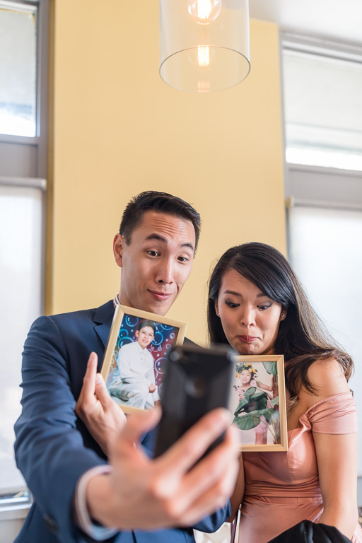 wedding guests having fun with funny selfies