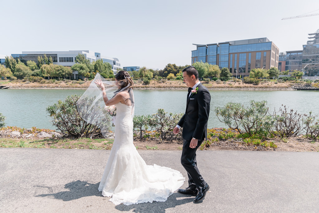 groom approaches bride from behind