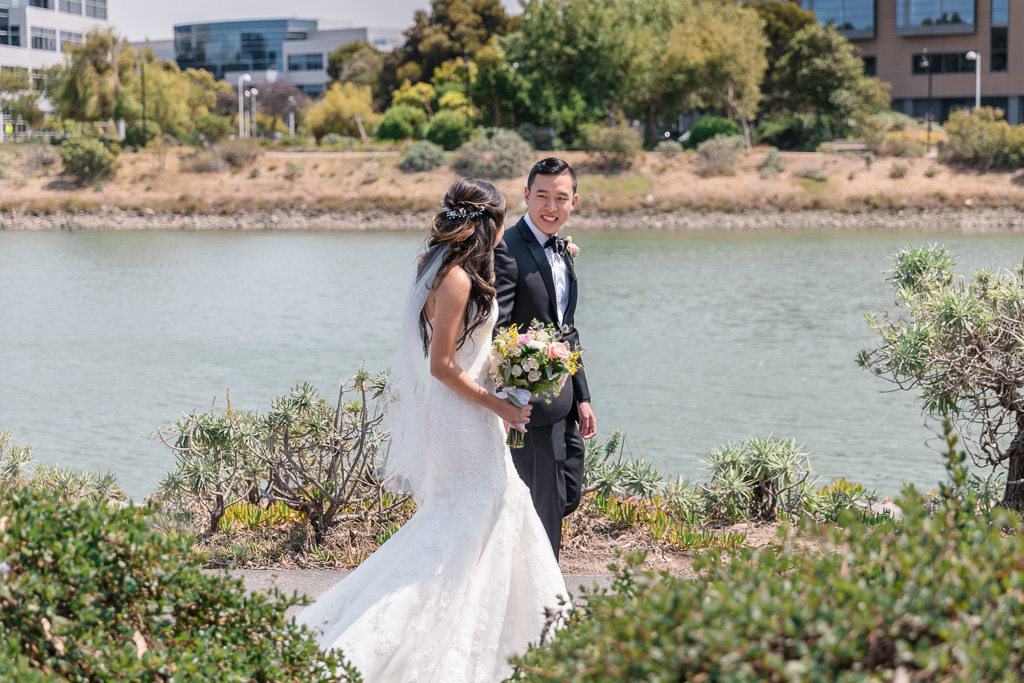 candid Oyster Point waterfront walking wedding photo after the first look