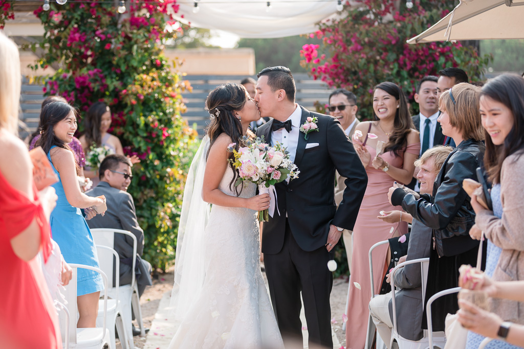 bride and groom's recessional kiss
