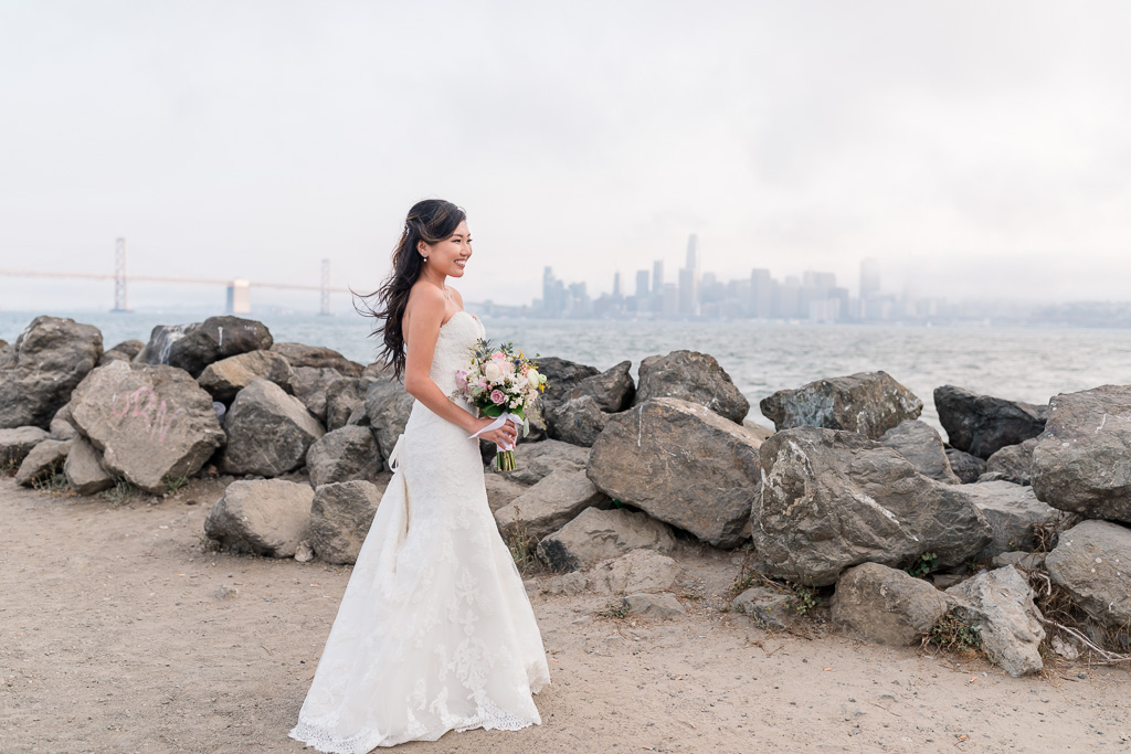stunning bride at Treasure Island waterfront overlooking the city skyline