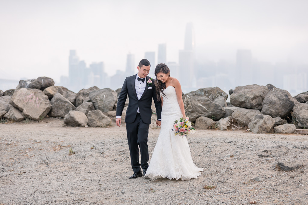 San Francisco wedding sweet candid moment with the city skyline background