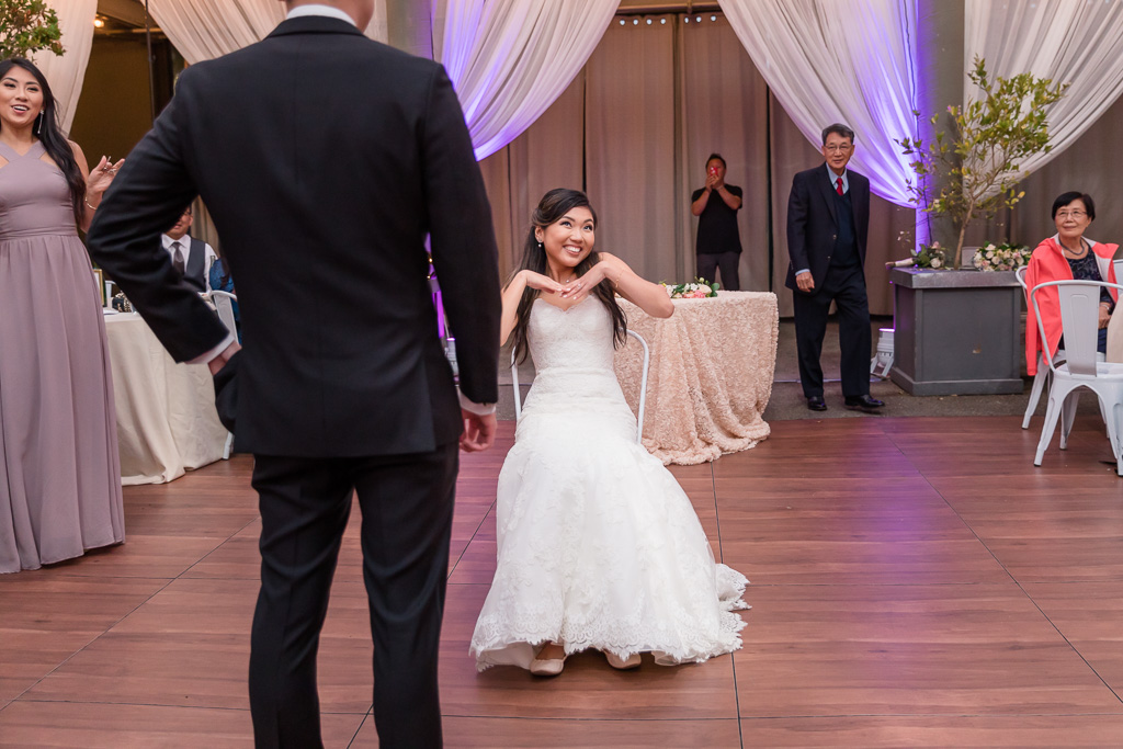 adorable bride is ready for the garter toss