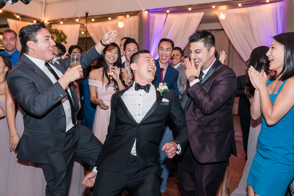 groom dancing with his crew