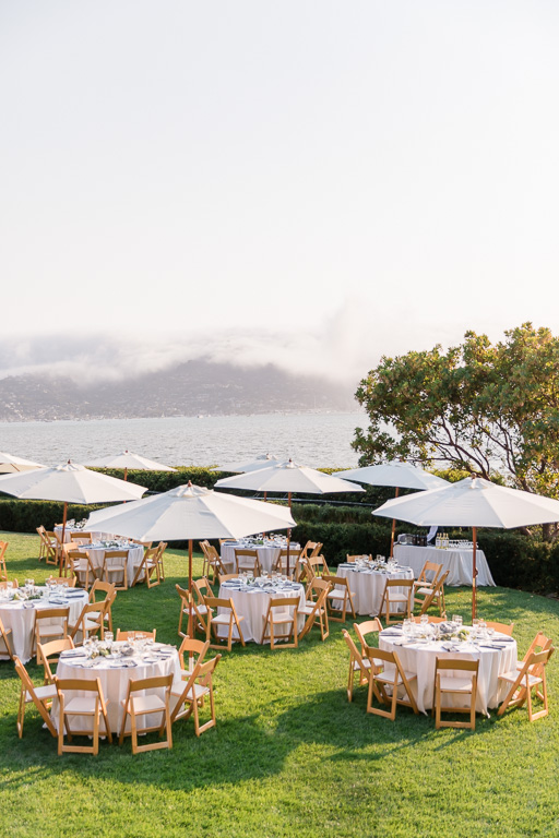 outdoor reception setup with umbrellas at Tiburon Landmarks Art & Garden Center