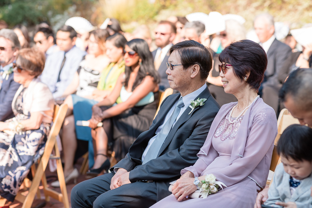 parents of the bride in the audience during ceremony
