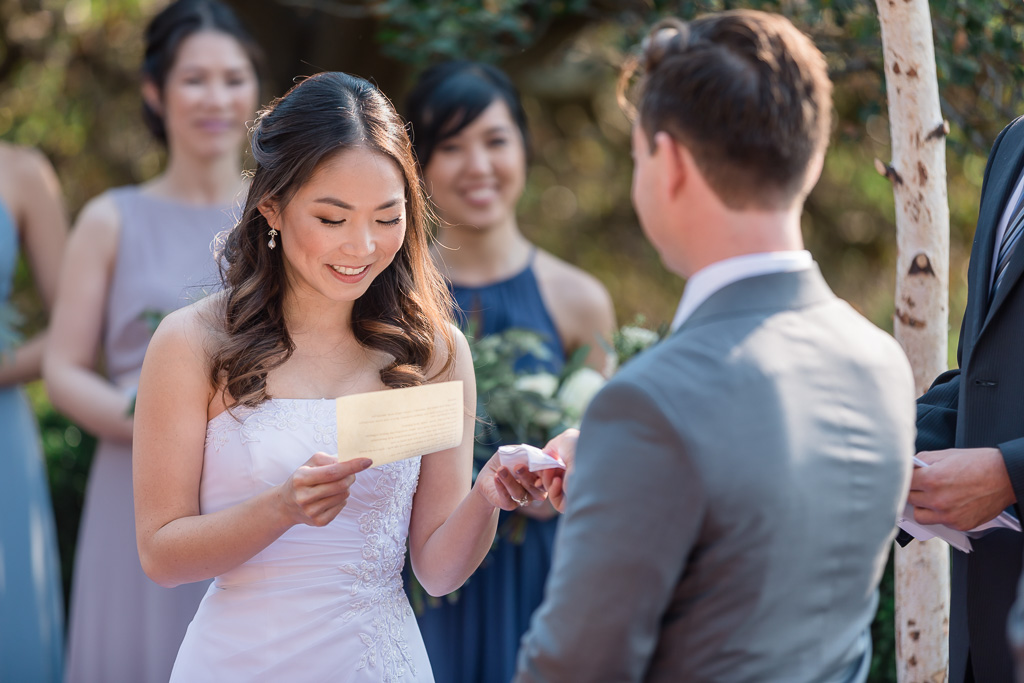 groom handing the bride a tissue during wedding ceremony