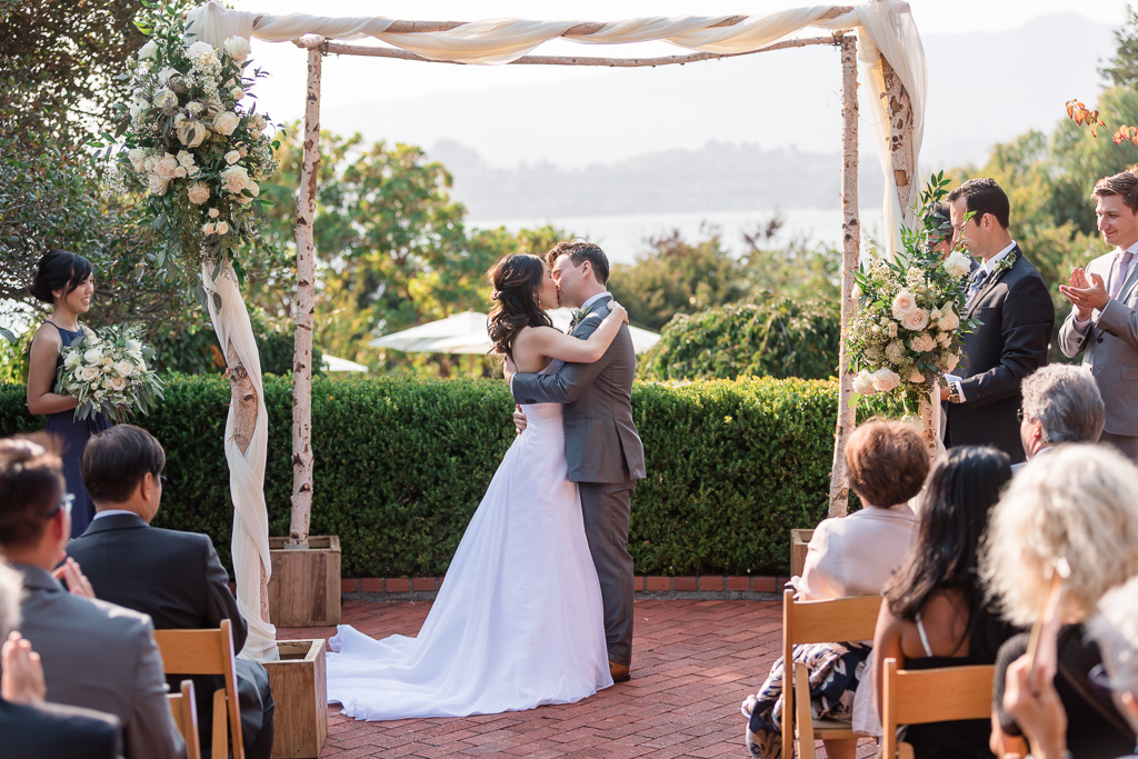 wedding first kiss at Landmarks Art & Garden Center in Tiburon