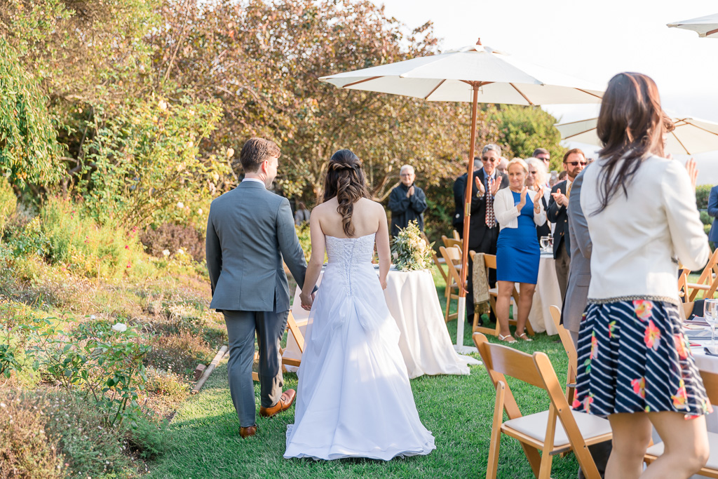 guests welcoming couple to their reception